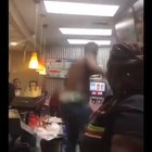 Man hops behind the counter at a restaurant, Good Samaritan intervenes and attempts to stop him