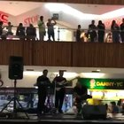 Flooding in a shopping center, band decides to play Titanic's music theme
