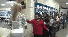 Teacher has a personalized handshake for each of her students