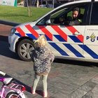 Dutch police racing a little girl on a bicycle