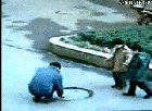 AssHole Playing With Manhole