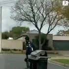 Meals on Wheels?!! Skateboarder cruises through neighborhood while towing a barbecue.