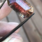 a 15.9 dichroic Oregon Sunstone that faceted with hand carved V grooves on the pavilion. a beautiful example of the deep red and green material that comes from Sunstone Butte Mine. Thanks for looking!
