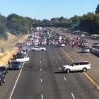 Idiots block busy interstate in California to do donuts.