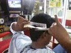 Man can cut his own hair with no help