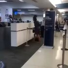 Lady freaks out on JetBlue staff.