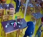 Group of men try to rob a restaurants. Patrons and owner fights back.