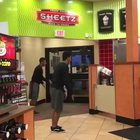 A guy flipping in a store