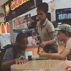 Fast food worker helping a disabled person to eat food
