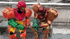 Samus cosplayers comparing blasters