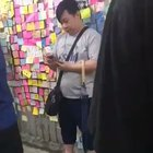 Standing Man: Hong Kong youngster standup against a man who was trying to destroy the Lennon Wall.